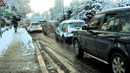 The long crawl home for drivers on the snow-covered streets of Norwich yesterday. Photo: Bill Smith