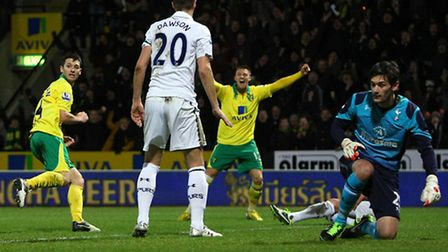 Wes Hoolahan wheels away in celebration after putting Norwich City ahead against Tottenham Hotspur.