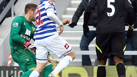 Norwich keeper Mark Bunn is adjudged to have hauled down QPR's Jamie Mackie - before saving the resu