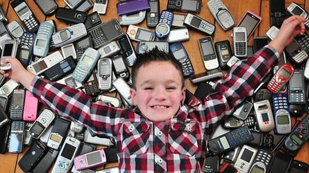 Tom Harper, 9, is collecting mobile phones to exhange for an iPad for a girl with autism in Walbersw