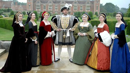 SIX WIVES: Ian Pycroft as Henry VIII with his six queens at a Blickling Hall Tudor pageant. From lef