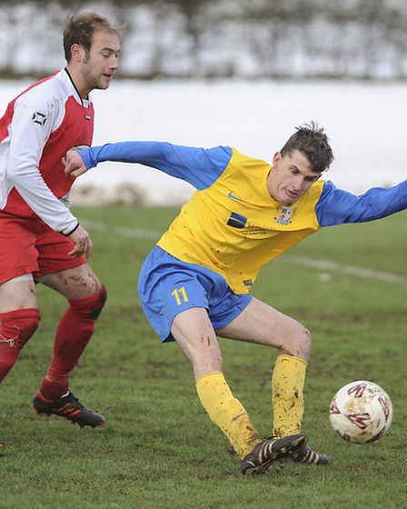 Action from Dersingham v Reepham - one of the only games played in Norfolk on Saturday, after anothe