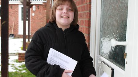 Ten-year-old Eleanor Bailey posting petition forms through letterboxes at Gresham, asking for suppor