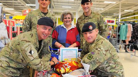 The Light Dragoons helping to pack people's shopping bags at Tesco in Beccles.Jan Wild who organised