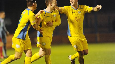 Sam Mulready, middle, celebrates his only goal in Lynn colours against Eastbourne. Picture: IAN BURT