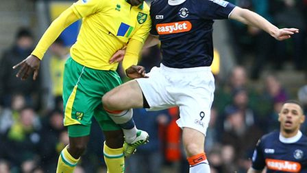 Luton striker Jon Shaw challenges Leon Barnett in the air. Picture by Paul Chesterton/Focus Images
