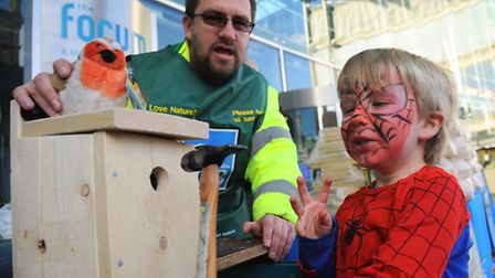 The RSPB Wild Garden weekend at the Forum. Spiderman, 5-year-old Frankie Welander, with one of the b