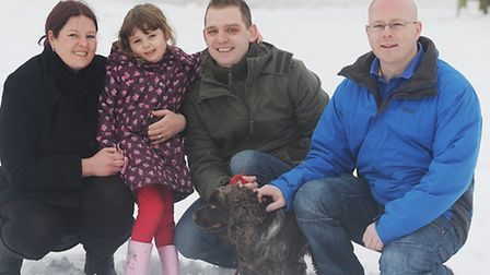 Pippin the dog with Marie Hollings, Summer Hollings (4) and Scott Hollings with hero (R) Andy Kelly.