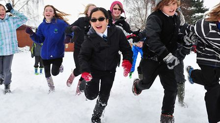 Open: Reydon primary school children having fun in the snow. The school was one of only a few that o