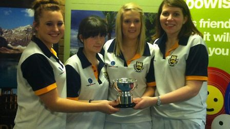 Harriett Segasby, Rebecca Carter, Louise Catchpole and Rebecca Field with the trophy they received f