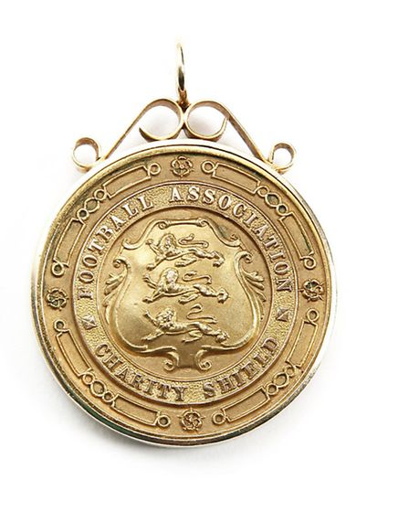 A gold medal won by Archie Macaulay, the man who masterminded Norwich City's record breaking FA Cup