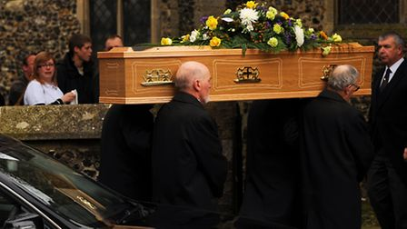 The family of Diss teenager Andrew Oakley watch as his coffin is taken into the town's St Mary's Chu