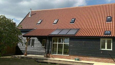 One of Greenright Homes' projects, featuring solar thermal panels