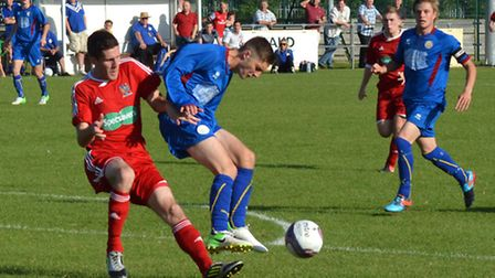 Wisbech Town, red, in action against Kirkley & Pakefield, are looking to switch leagues if their pro