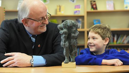Dennis O'Callaghan with (R) George Le Bon with a statue of Private William O'Callaghan carrying Priv