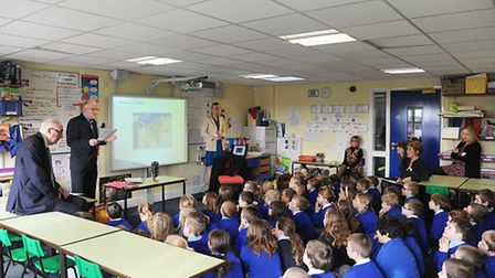 John Head and (standing) Dennis O'Callaghan were at Scarning Primary School to give a talk about Den