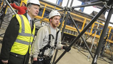 MP Henry Bellingham with a young apprentice at the National Construction College in Bircham Newton