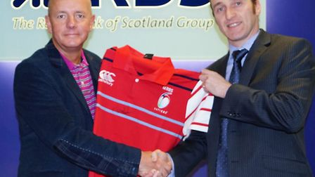 Lord Baker receiving a RBS six-nations rugby shirt which is just one of the items to be auctioned of