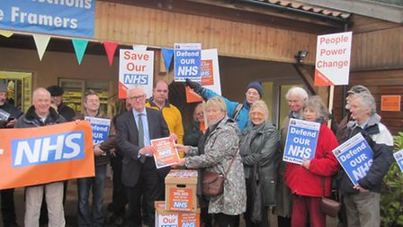 Health minister Norman Lamb receives the 38 Degrees petition.