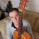 Ken Irving who has bowel cancer. He was going to sell his beloved acoustic guitar but the distributi