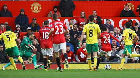 Shinji Kagawa scores Manchester United's third goal to complete his hat trick. Picture: Paul Chester