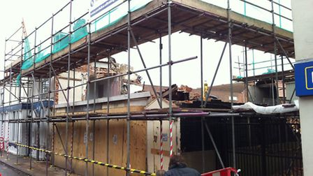 Demolition work at the PACT charity shop in Dereham started early on Saturday February 2. This was t