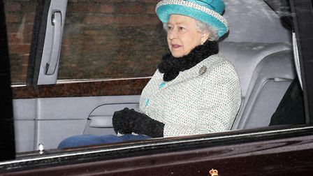 The Queen leaves by car after attending the church service at Sandringham yesterday. Picture: Matthe