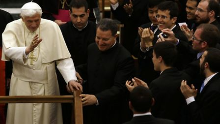 Pope Benedict XVI blesses faithful at the end of his visit at the Roman seminary, in Rome Sunday, Fe