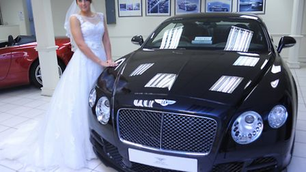 Model Sam Baxter, in a La Belle Angele wedding dress with a Bentley Continental GT Speed worth £181,