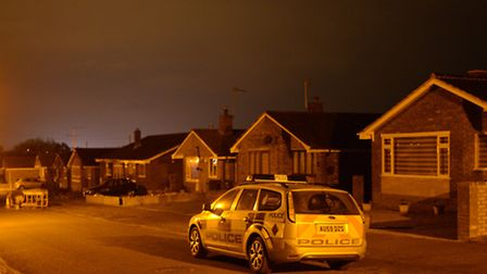Police outside the house in Upper Grange Crescent, Caister on Sea. Photo: Bill Smith
