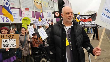 Mark Harrison, CEO of the Norfolk Coalition of Disabled People, with other campaigners protesting ag