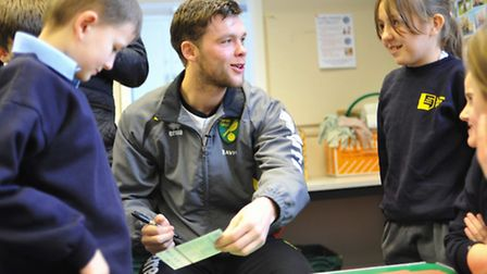 NCFC star Jonny Howson talking to youngsters at Larkman primary school as part of the premier league