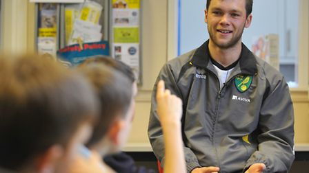 NCFC star Johnny Howson talking to youngsters at Larkman primary school as part of the premier leagu
