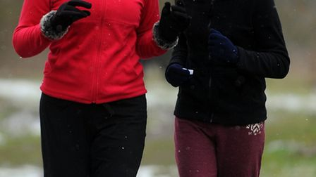 Runners take part in the first Thetford Park Run on Abbey Meadows in the town despite a dusting of s