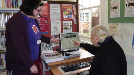 librarian Charlotte Clark giving regular library user Tony Seago a tour round the Reydon Village we