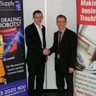 Karl Alderton (left) of Comms Supply with Richard Pledger of React CP. The two companies have formed
