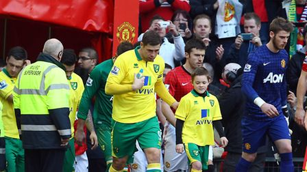 The Norwich City players take to the pitch before the game. Picture: Paul Chesterton / Focus Images