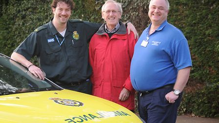 Centre, Roy Watts, who had a heart attack, pictured with the men who saved his life, left, paramedic