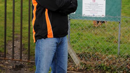 Chairman of Diss Cricket Club Martin Fairweather next to the gate and and sign next to the Rectory M