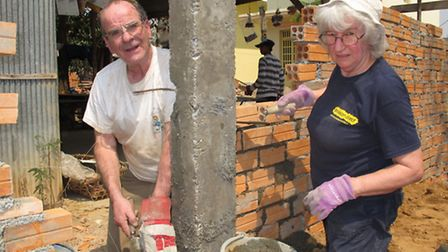 Cambodia couple Brian Cutting and June Jones working on the school building