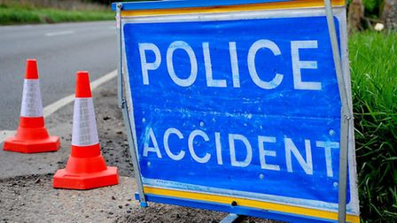 A woman was taken to hospital following a road accident