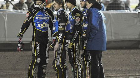 Mads, front middle, checks out the state of the track during Lynn's clash with Peterborough at the N