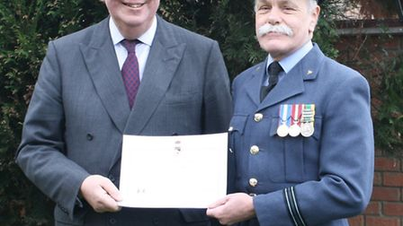 Dave Chart receiving his certificate of commendation from Lord Lieutenant of Norfolk, Richard Jewson