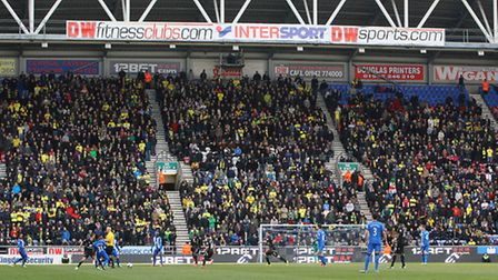 The massed ranks of Norwich City fans behind one goal at the DW Stadium.