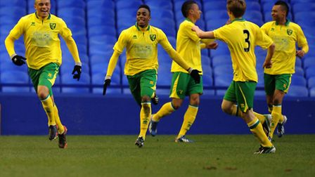 Norwich City players celebrate a goal scored by hat-trick hero Carlton Morris in the 4-2 win at Ever