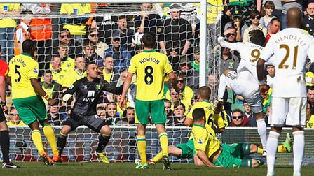 Michu lashes in this half chance to give Swansea the first goal - but later missed two better ones.