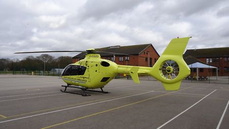 Air ambulance on the playground at Taverham High School where a pupil fell from a pommel horse durin