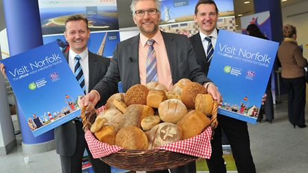 Visit Norfolk Chairman Mark Durrant(left) and Brand Manager Pete Waters(right) with Chris Scargill who presented the...