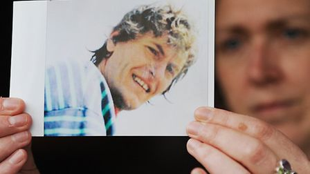 Shona Lidgey holds a picture of her husband David Lidgey who went missing a year ago and has not bee