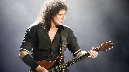 Brian May frm Queen, whose signed guitar is a star lot at the charity Live Aid event.